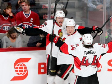 Patrick Wiecioch sticks out his tongue as he celebrates his goal with Curtis Lazar and Jean-Gabriel Pageau in the first period as the Ottawa Senators take on the Montreal Canadiens at the Bell Centre in Montreal for Game 5 of the NHL Conference playoffs on Friday evening.