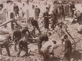 Workers comb through the rubble of Villa  St. Louis after the 1956 plane crash that killed 15.