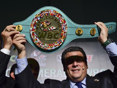 The president of the World Box Council,  Mauricio Sulaiman holds on April 21, 2015, in Mexico City, the belt, made in Mexico, that will be delivered to the winner of the fight between filipino Manny Pacquiao and US Floyd Mayweather Jr. next May 2.