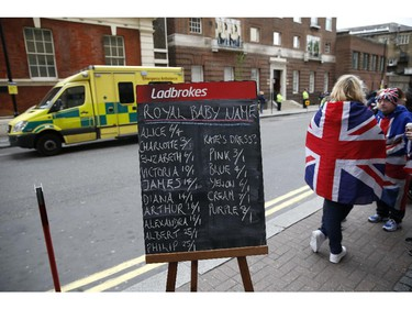 A chalkboard displays the latest betting odds on the name of Catherine, Duchess of Cambridge and Prince William's second child outside the entrance to the Lindo wing at St Mary's hospital in central London, on May 2, 2015 after the announcement was made by Kensington Palace that Catherine was admitted to hospital on May 2 in the early stages of labour.