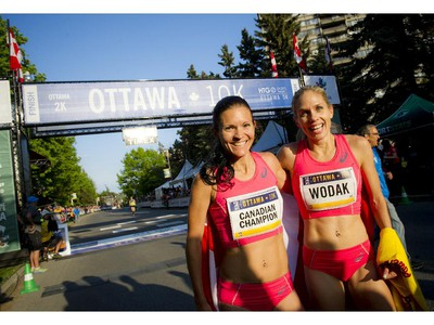 Lanni Marchant poses with fellow Canadian runner Natasha Wodak, right, at the 10K finish line.