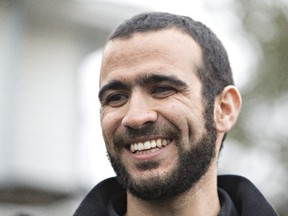 Omar Khadr speaks to media after being released on bail in Edmonton, Alta., on Thursday, May 7, 2015. After 13 years in prison, former Guantanamo Bay prisoner Omar Khadr is getting his first taste of freedom. Khadr is out on bail after an Alberta judge rejected a last-ditch attempt by the federal government to block his release.