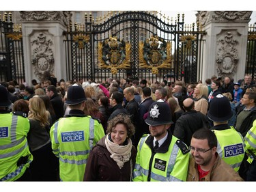 LONDON, UNITED KINGDOM - MAY 02:  Thousands of people line up for a chance to glimpse and photograph the announcement of the birth of Prince William, Duke of Cambridge and the Duchess of Cambridge's second child outside Buckingham Palace on May 2, 2015 in London, United Kingdom. The baby girl arrived at 8:34am Saturday and is the fourth in line to the throne and the Queen's fifth great-grandchild.