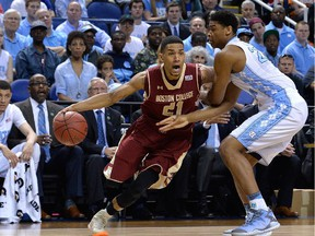 Olivier Hanlan #21 of the Boston College Eagles drives on  Isaiah Hicks #22 of the North Carolina Tar Heels during a second round game of the ACC basketball tournament at Greensboro Coliseum on March 11, 2015 in Greensboro, North Carolina.