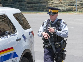 An RCMP officer carries an automatic weapon while patrolling on Parliament Hill this week.