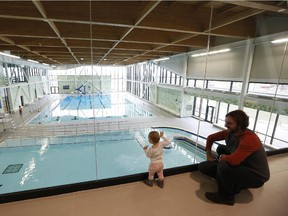One-year-old Élise Black and father Thierry inspect the Minto Recreation Complex at its opening in south Barrhaven in late 2014. No corporate partner has come forward to help build a similar centre in Riverside South.