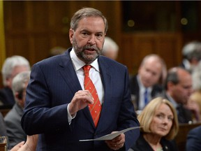 NDP Leader Tom Mulcair asks a question during question period in the House of Commons on Parliament Hill in Ottawa on Monday, June 15, 2015.