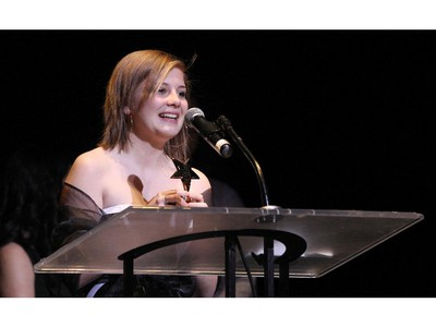 The winner(s) for Supporting Actress in a Musical: Olivia Coffin, Merivale High School for Singin' in the Rain, accept(s) their award, during the 10th annual Cappies Gala awards, held at the National Arts Centre, on June 07, 2015.