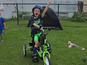 Mason Moffat Brozincevic rides his new adaptive bicycle. Children at Limoges Child Care wanted to help out with the cost of the bike, so they held a fundraiser.