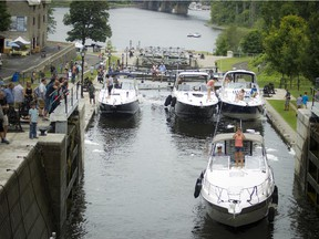 Large boats make their way through the Ottawa Locks at the Rideau Canal and the Ottawa River in July 2015.