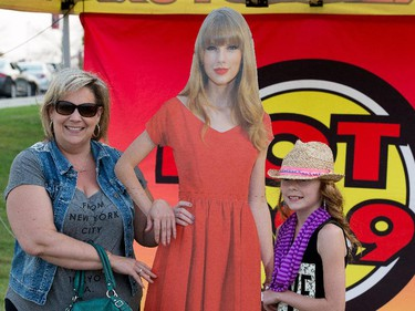 Valerie Seeley and her daughter Arianna pose with a cutout of Taylor Swift.