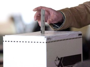 A man casts his vote for the 2011 federal election in Toronto in this May 2, 2011 photo.