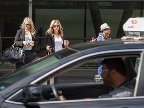 Airport passengers wait for rides as cabbies continue with their noisy protest outside the Ottawa airport terminal Thursday as their dispute over a $5 per fare service fee continues.