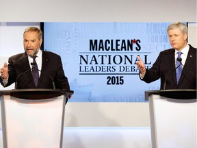 Canada's NDP leader Thomas Mulcair (L) and Conservative leader Prime Minister Stephen Harper both speak during the Maclean's National Leaders debate in Toronto, August 6, 2015.