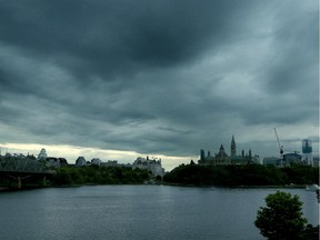 Dark clouds form over the capital's Parliament Hill as a storm rolls into Ottawa last Thursday evening.