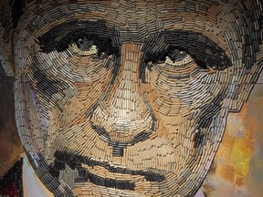 This photo taken on Wednesday, July 22, 2015, shows a portrait of Russian President Vladimir Putin, made by Ukrainian artist Dasha Marchenko out of cartridge cases.