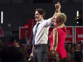 Liberal Leader Justin Trudeau campaigns with Ontario Premier Kathleen Wynne during a stop in Toronto on Monday, Aug. 17, 2015.