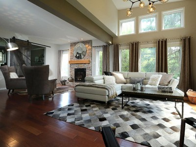 The family room is divided into two distinct spaces. 'The biggest problem Lise was having when I got here, is she didn't know how to decorate this long space,' says Tait.
