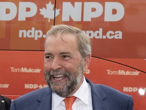 NDP Leader Tom Mulcair smiles while campaigning  in Stratford, Ont., on Wednesday, August 26, 2015.