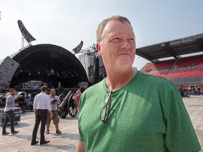 """AC/DC production manager Dale """"Opie"""" Skjerseth in front of the stage at TD Place in Ottawa on Wednesday. (Wayne Cuddington/ Ottawa Citizen)"""