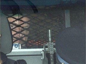 Basil Borutski leaves in a police vehicle after appearing at the courthouse in Pembroke.
