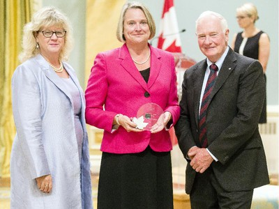 Dale Cindy Sharkey from Veterans Review and Appeal Board receives the Public Service Award of Excellence for Outstanding Career from Janice Charette, clerk of the privy council, left, and David Johnston, Governor General of Canada, right, at Rideau Hall Wednesday September 16, 2015. (Darren Brown/Ottawa Citizen) - Assignment 121627