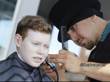 Jonathan Pitre gets a cut by House of Barons senior barber, James Fowler, during a promotional event in the Byward Market Thursday September 10, 2015 for Opera Lyra's Figaro, the Barber of Seville, which runs from Saturday September 26 to Saturday October 3 at the National Arts Centre. (Darren Brown/Ottawa Citizen)