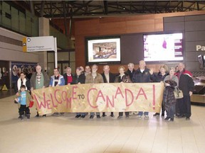 Church sponsorships are a traditional way to help refugees settle in Canada. Here, parishioners from St. Martin de Porres Catholic Church in Nepean greet a family from Syria arriving at the Ottawa airport.