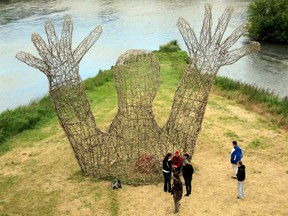 Marc Walter uses natural materials like wood, rock and earth in his Land Art sculptures. His eight-metre tall L'Embrassade (The Hug) creation, a three-week project in France, contains a red heart.