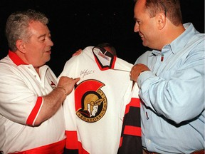 Max Keeping, left, joins Robert Lendvai to give out an Ottawa Senators sweater signed by Wade Redden at a fundraising event in 1998.