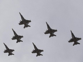 CF-18 Hornets fly in formation on their the departure for Operation IMPACT, in Cold Lake, Alberta on Tuesday October 21, 2014. The Canadian CF-18 Hornets were making their way to Kuwait, to join the fight against the Islamic State of Iraq and Syria.