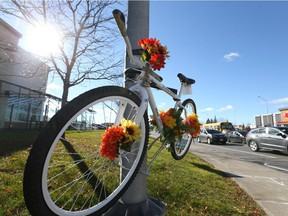 Ghost bike that pays tribute to Mario Theoret at Hunt Club and Merivale roads, Oct. 30, 2015.