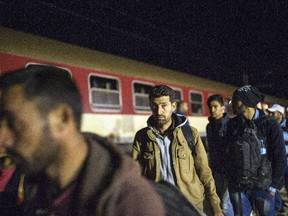 Migrants and refugees board a train, after crossing the Greek-Macedonian border, near Gevgelija on October 6, 2015. Macedonia is a key transit country in the Balkans migration route into the European Union, with thousands of asylum seekers and migrants - many of them from Syria, Afghanistan, Iraq and Somalia - entering the country every day. The EU said a controversial programme to relocate 40,000 refugees within the bloc from overstretched frontline states would formally start on October 9 when a group of Eritreans will travel to Sweden from Italy.