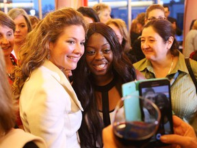 Sophie Gregoire-Trudeau, left, poses for a photo with Antoinette Hunte-Jacob at the Harvest Moon Extravaganza at the Wabano Centre for Aboriginal Health, October 27, 2015.  The crowd was very happy to share brief moments with her.