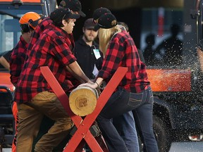 Traditional log cutting ceremony after a RedBlacks' touchdown.