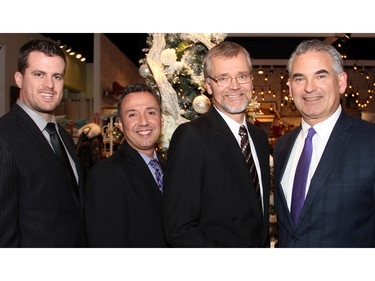 From left, PhD student Dan McEwen, Bruyère clinical manager Mario DaPonte, Dr. Frank Knoefel and Bernie Forestall, a vice president with the Bruyère Foundation, helped out at the Fashion FUNraiser benefit held at Shepherd's store on Monday, November 23, 2015, in support of Bruyère.