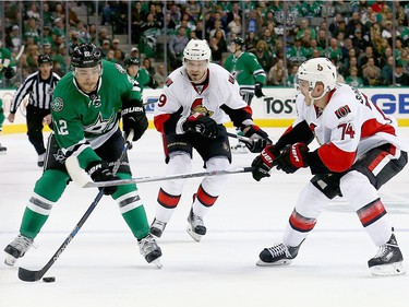 Colton Sceviour #22 of the Dallas Stars controls the puck against Mark Borowiecki #74 of the Ottawa Senators and Milan Michalek #9 of the Ottawa Senators in the first period at American Airlines Center on November 24, 2015 in Dallas, Texas.