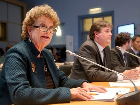 Sally Southey (left, beside city staff), a resident of the Sandy Hill area, was not happy with the Upper Rideau Community Design Plan (UPCDP) at city hall's planning committee meeting Tuesday.  She says the exemption at 560 Rideau Street, to make way for a high rise tower, is wrong. The development is being appealed to the OMB. (Julie Oliver / Ottawa Citizen)