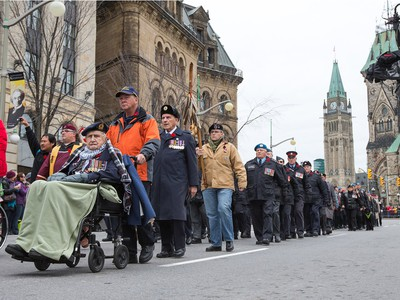 Veterans march in the parade as the National Remembrance Day Ceremony takes place at the National War Memorial in Ottawa.