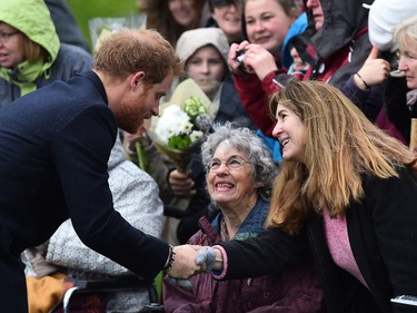Britain's Prince Harry greets wellwishers after attending a traditional Christmas Day Church Service at Sandringham in eastern England, on December 25, 2015.