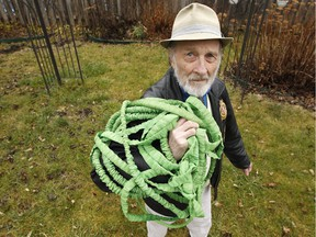 Kevin Murray shows off the punctured garden hose.