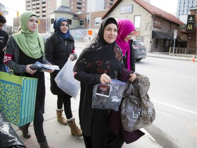 Sana Nooraldeen, centre,  and a group of students forming a chapter of Who is Hussain gathered to hand out packages to people in need outside the Ottawa Mission and surrounding area. The packages contained a winter hat, mittens, and a pair of thick socks.