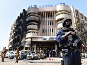 A policeman stands guard in front of the Splendid hotel, on January 17, 2016 in Ouagadougou, following a jihadist attack by Al-Qaeda linked gunmen late on January 15.   At least 29 people, including at least 12 foreigners, were killed in an Al-Qaeda attack on a top hotel in Burkina Faso, an unprecedented strike in the capital illustrating the expanding reach of regional jihadists.