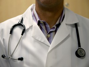 MIAMI, FL - JUNE 02:  A doctor wears a stethoscope as he see a patient for a measles vaccination during a visit to the Miami Children's Hospital on June 02, 2014 in Miami, Florida. The Centers for Disease Control and Prevention last week announced that in the United States they are seeing the most measles cases in 20 years as they warned clinicians, parents and others to watch for and get vaccinated against the potentially deadly virus.