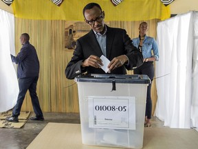 FILE - This is a  Friday, Dec. 18, 2015 file photo of President of Rwanda, Paul Kagame as he casts his ballot,  in Kigali.  Rwandan President Paul Kagame declared Friday  Jan. 1, 2016 that he will run for a third term in office after his second seven-year term expires in 2017, a move opposed by the U.S., a key ally.