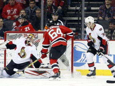 New Jersey Devils center Joseph Blandisi (64) scores his first career goal against Ottawa Senators goalie Craig Anderson (41) during the first period.