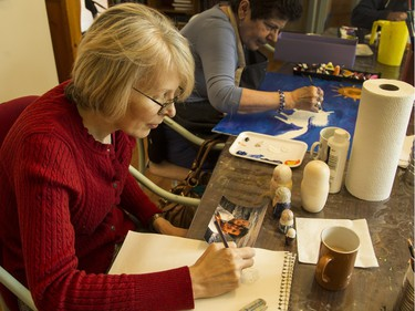 Mary MacKinnon takes part in the day hospice program at May Court. She is creating a series of nesting dolls depicting seven generations of her family, which she plans on giving to her son, Liam, as a remembrance.