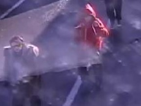 Police are seeking a warrant for Devin Huff, in red hoodie, in connection  with an OC Transpo pepper spray attack.