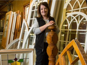 A maple newel post and several decorative windows were among the treasures that Myrna Beattie's Habitat team salvaged from six Glebe homes.