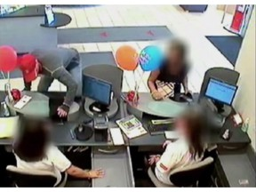 """A series of bank robberies involving the """" Vaulter Bandit """" shown in this frame grab from video courtesy of York Regional Police Service, started in 2010. Between February and August 2010, it is reported he committed seven bank robberies in Vaughan and Markham by jumping over the teller counter, emptying the cash drawers and jumping back over the counter before fleeing."""
